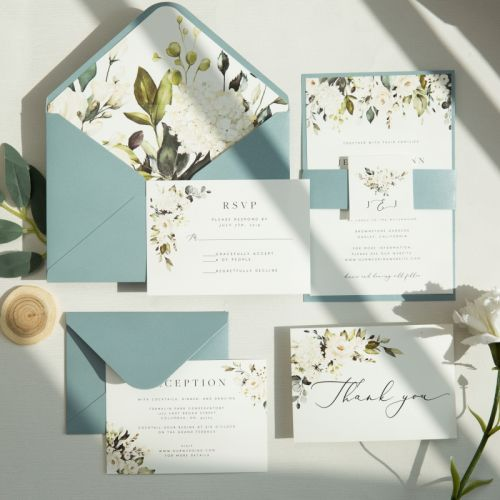 white blooms and greenery wedding invites with dusty blue paper backer EWIS010