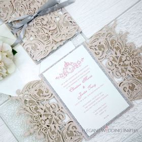 gorgeous pink and silver laser cut wedding invitations with silver ribbon and silver glitter backer EWTS074-1