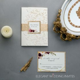 ivory laser cut pocket wedding invitations with floral pattern around framed wording EWDM009