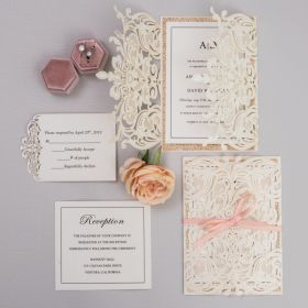 ivory laser cut wedding invitation with rose gold paper and peach ribbon EWWS200