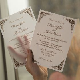 translucent vellum invitation with raised uv printing technology and classic pattern corners EWUV034