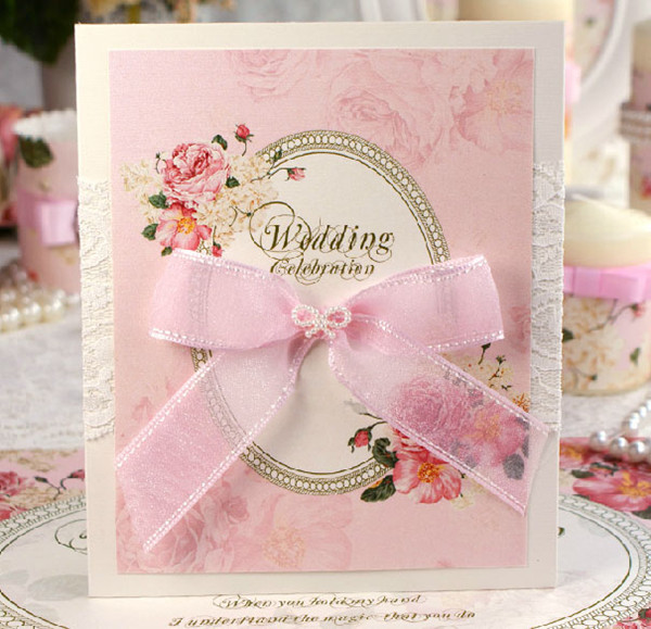 pink vintage floral wedding invitations decorated with ribbon and lace