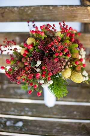 cranberry red wedding bouquets for christmas themed wedding ideas