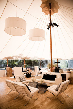 sperry tent with drum lights over the lounge area for summer wedding ideas
