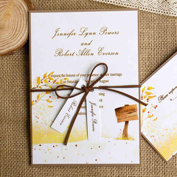 country rustic fall yellow wedding invitation cards with ribbon tied