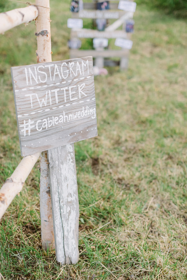 wooden wedding sign with instagram hastag ideas