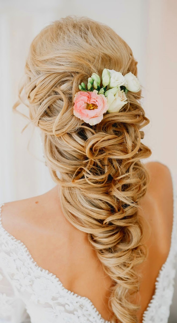 Braided Romantic Wedding Hairstyles With Flowers For Spring Weddings · Boho  Themed Wedding Hairstyle Ideas For Long Hair Brides