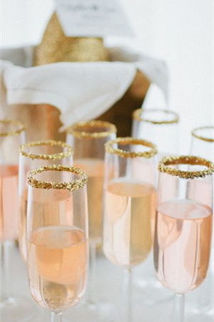 gold glittering champagne glasses for sparkling wedding ideas