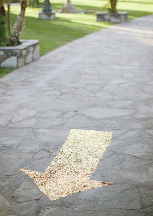gold sequined arrow that shows guests where to go