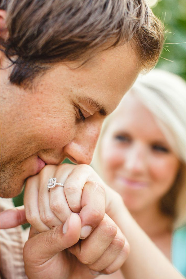 ring show off kiss engagement photo ideas