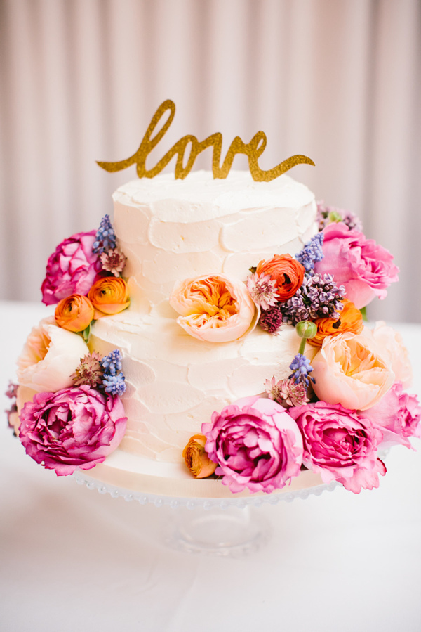 two tiers wedding cakes decorated with colorful flowers