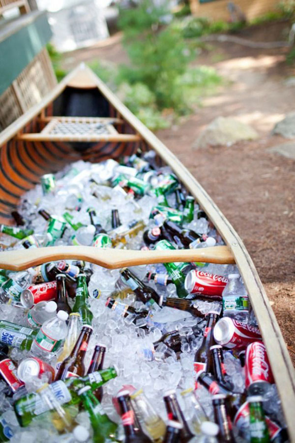 creative boat filled with drinks for outdoor wedding ideas