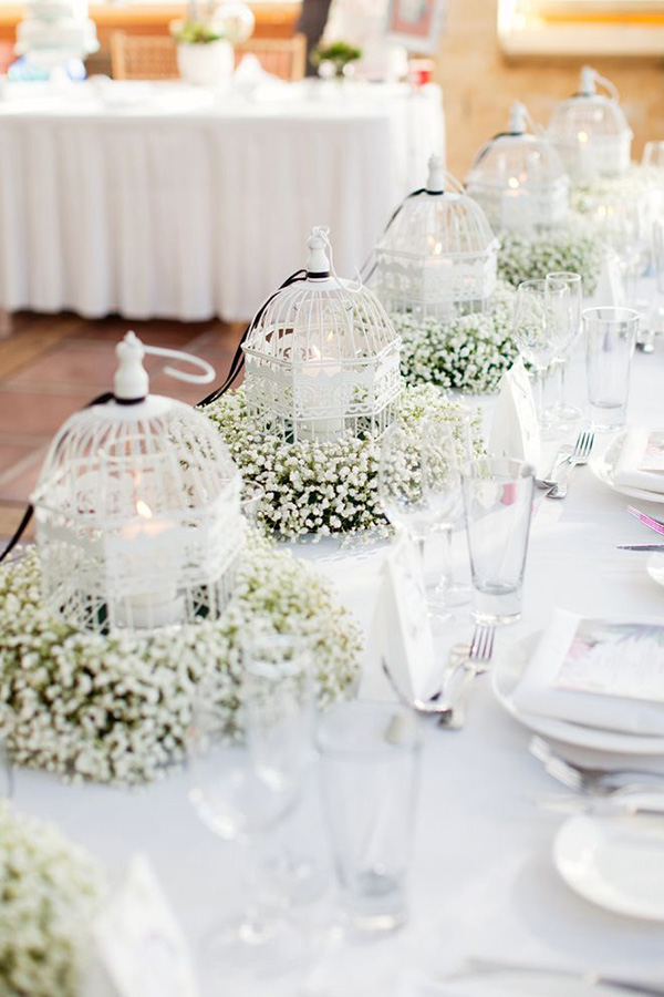 baby's breath in lanterns rustic wedding centerpiece ideas