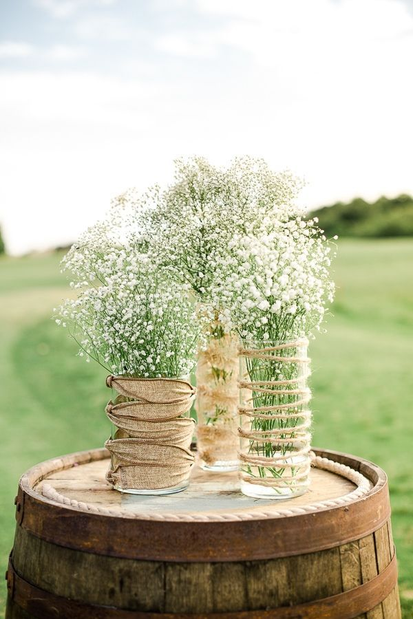 lace and burlap country wedding ideas with baby's breath and wine barrels
