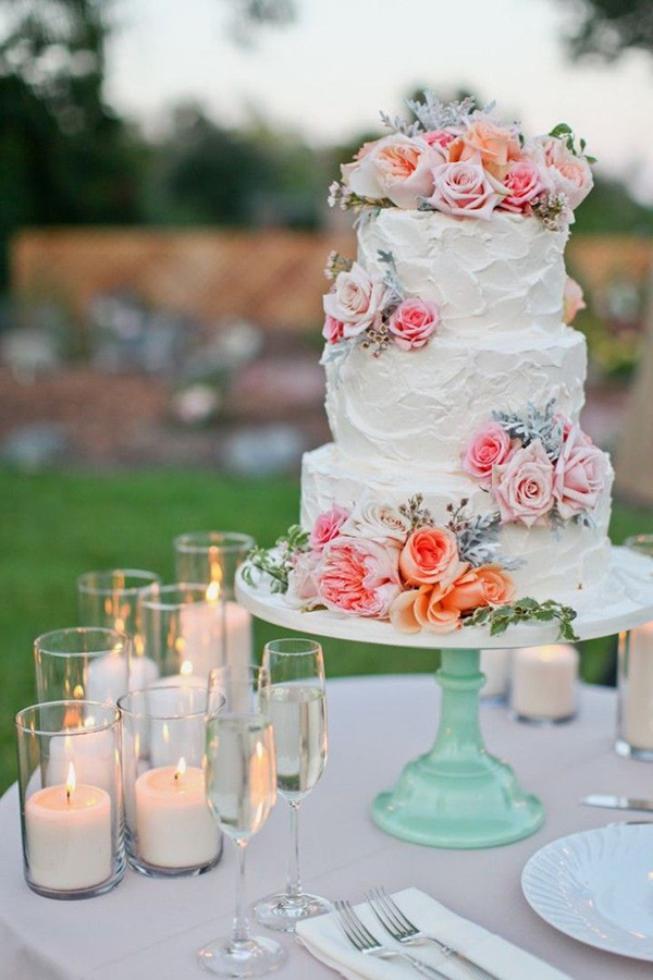 mint pink and peach wedding cakes with floral decorated