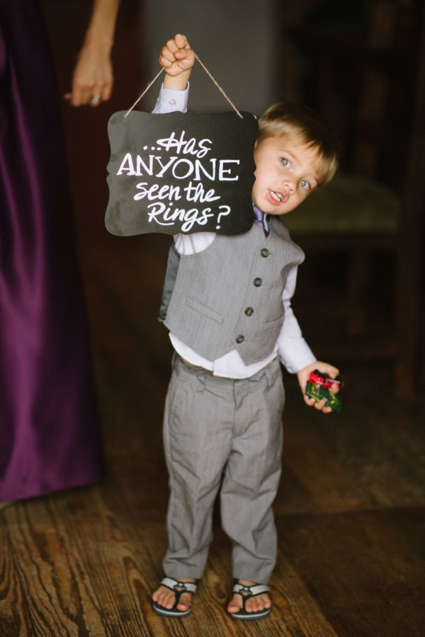 adorable ring bearer with chalkboard wedding signs
