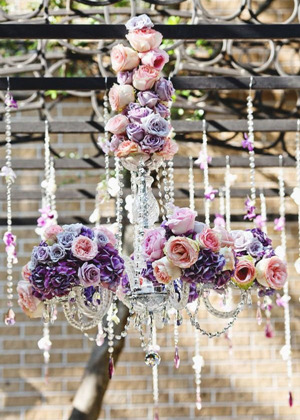 amazing crystal chandelier covered in purple and pink rose for outdoor wedding ideas