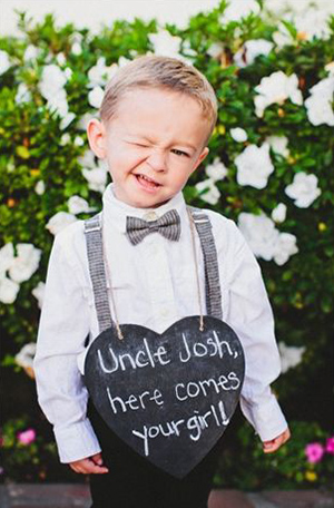 cute ring bearer with chalkboard wedding signs