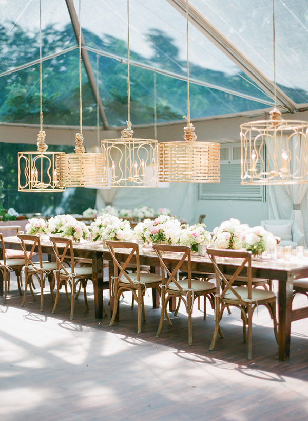 glass tented country wedding reception decoration ideas with  gilded lighting fixtures