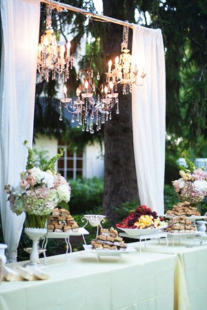 outdoor wedding food buffet with hanging chandeliers