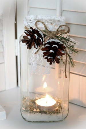 winter wedding centerpieces with mason jars lace and burlpa and pine cones