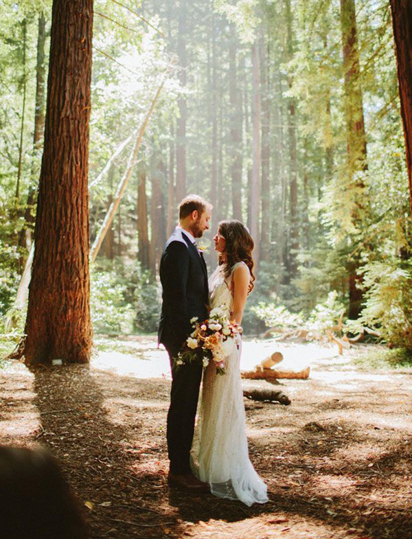 Gorgeous portrait of the bride and groom in the forest