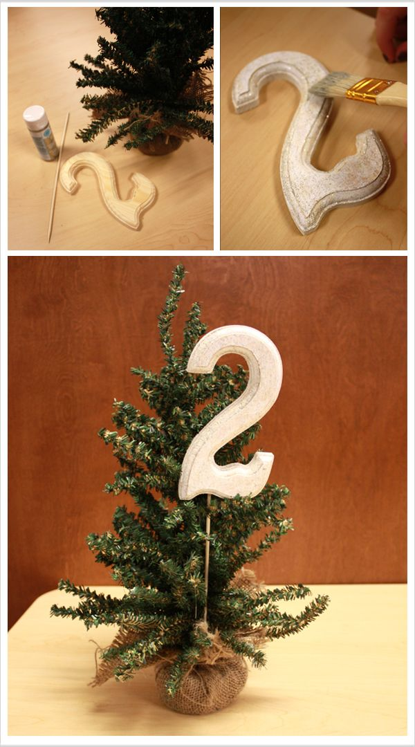 Easy DIY pine tree table numbers for a winter wonderland or christmas wedding