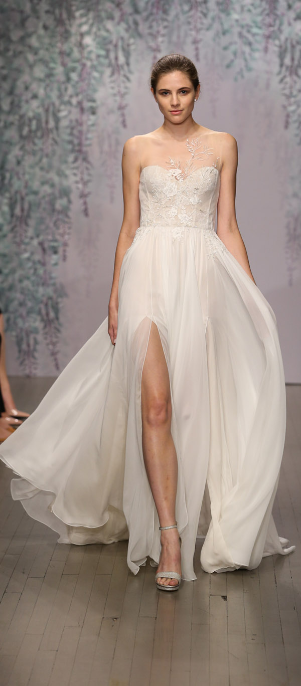Monique Lhuillier sleeveless illusion embroidered bridal gown with flowing chiffon skirt