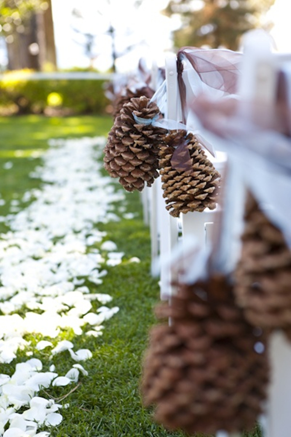 creative wedding decors of pinecone aisle markers