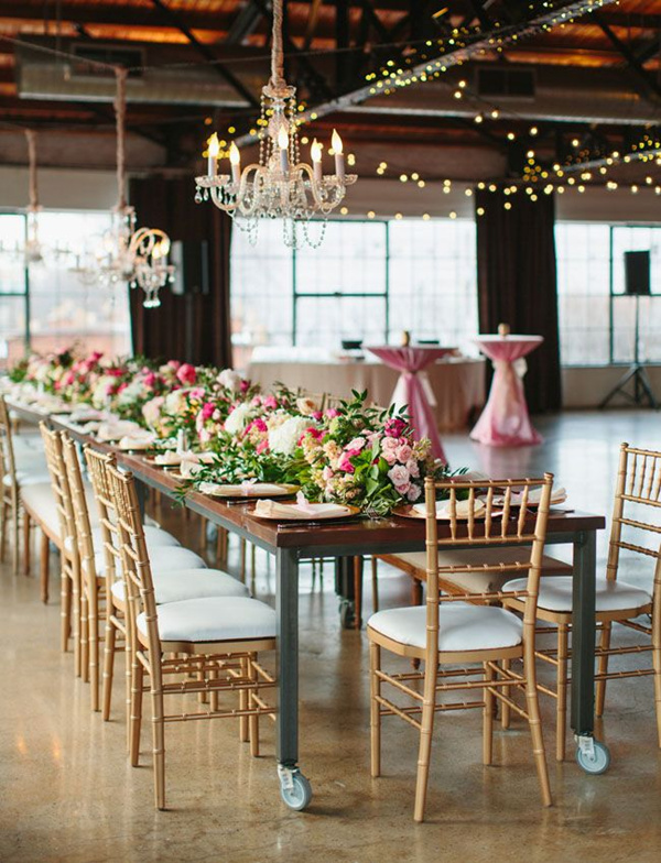pink and gold wedding tablescape with a chandelier