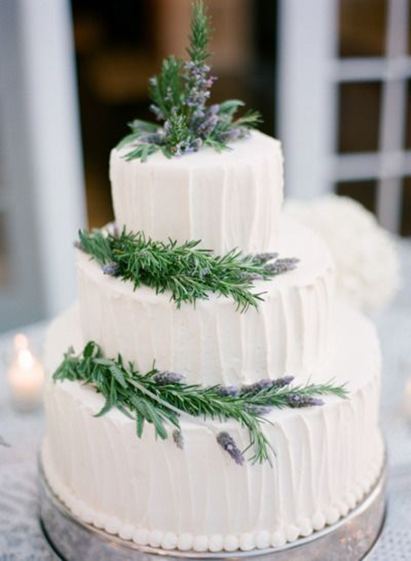 white wedding cake with pine tree decors