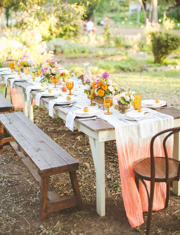 Beautiful ombre tablecloths and outdoor tables with colorful flowers