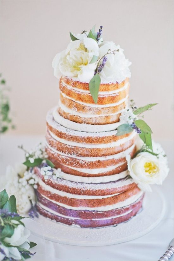 Lavender naked wedding cake with floral topper