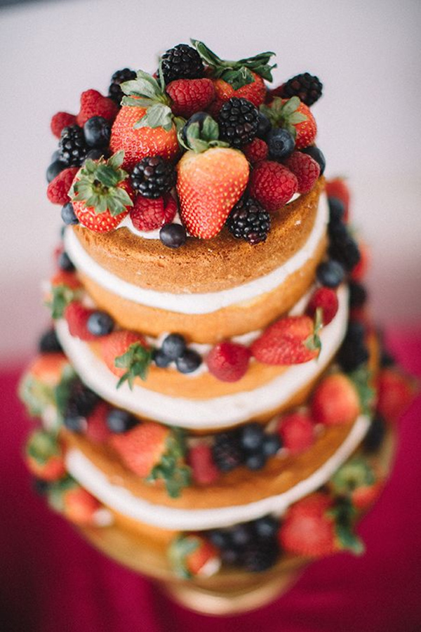 Naked wedding cake with berries and cream