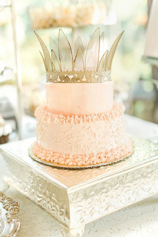 beautiful pink wedding cake with a vintage gold crown