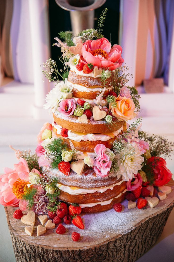 fun-filled spring naked wedding cake decorated with shortbread hearts and flowers