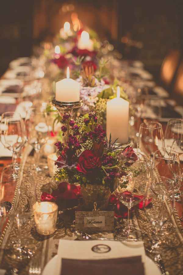 incredible winter wedding tablescape with deep red roses and crystal