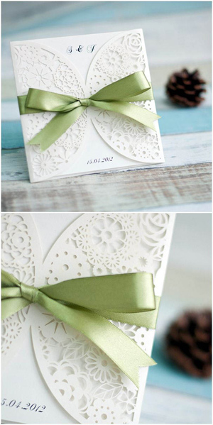 laser cut elegant wedding invitations with green ribbons