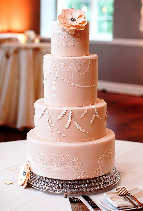 pretty pale-pink wedding cakes with a glamorous chandelier pattern
