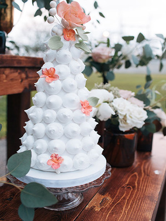 unique white wedding cake decorated with sugar flowers