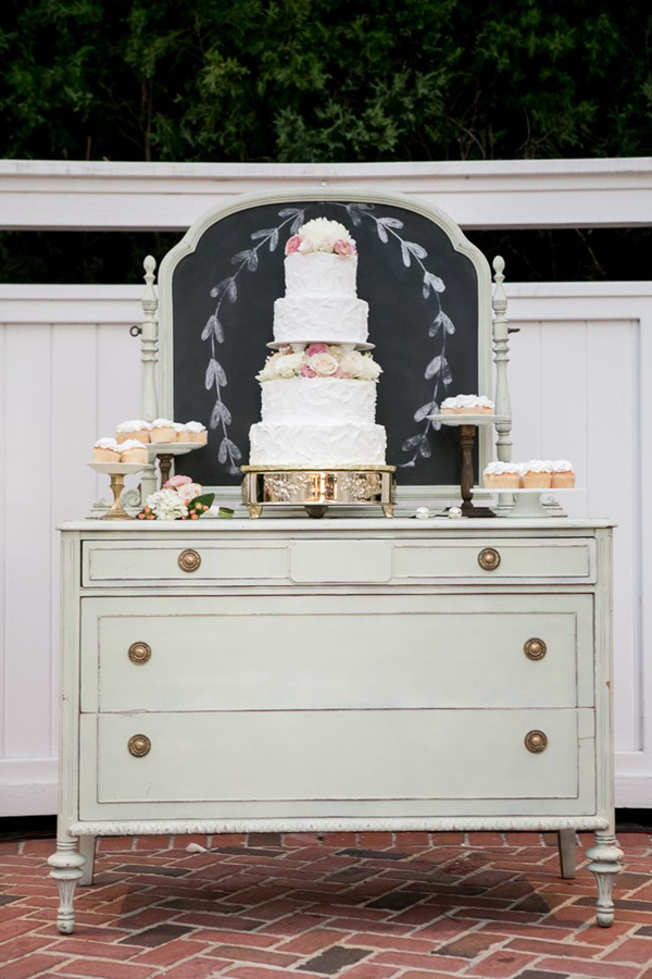 vintage wedding dresser used as cake and dessert stand