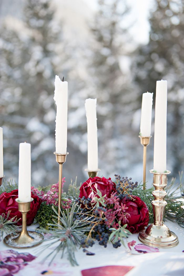 winter wedding inspiration with pine needle and red floral table garland
