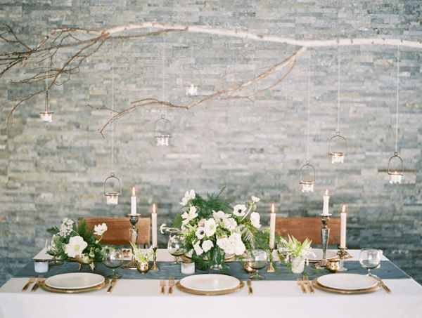 winter wedding tablescape ideas candlesticks and white floral