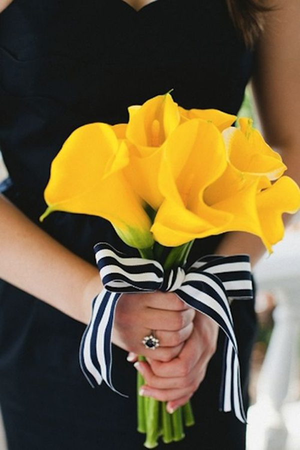 Yellow calla lily bridesmaid bouquet with striped ribbon