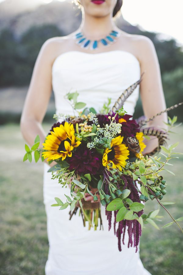 autumn wedding bouquet with sunflowers and feathers