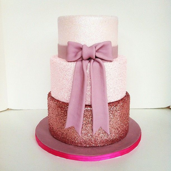 glittery wedding cake with pink bow