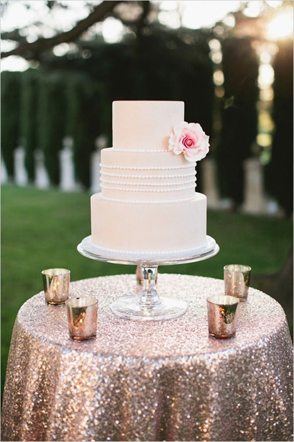 gold glitter cake table with blush sequin linens