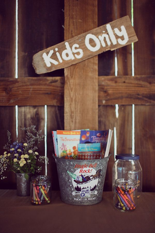 kids only coloring table and wedding signs