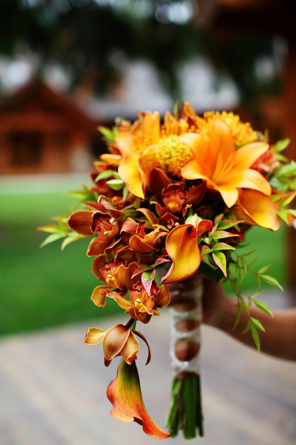 mixture of brown and burnt orange and calla lilies camop wedding bouquet ideas