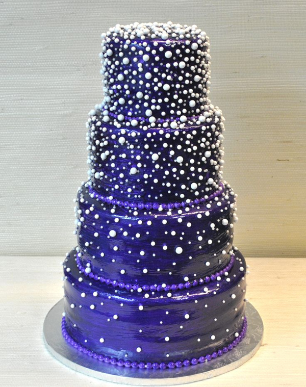 purple and white cascading wedding cake with pearl details